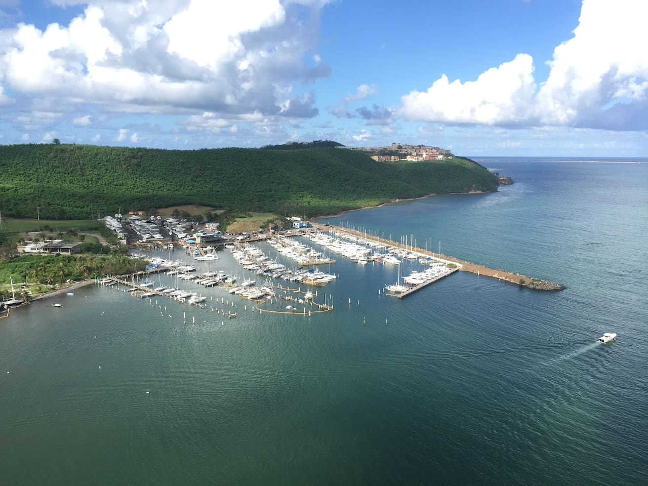 View from the apartment balcony to the marina and the El Conquistador Hotel & Resort.
