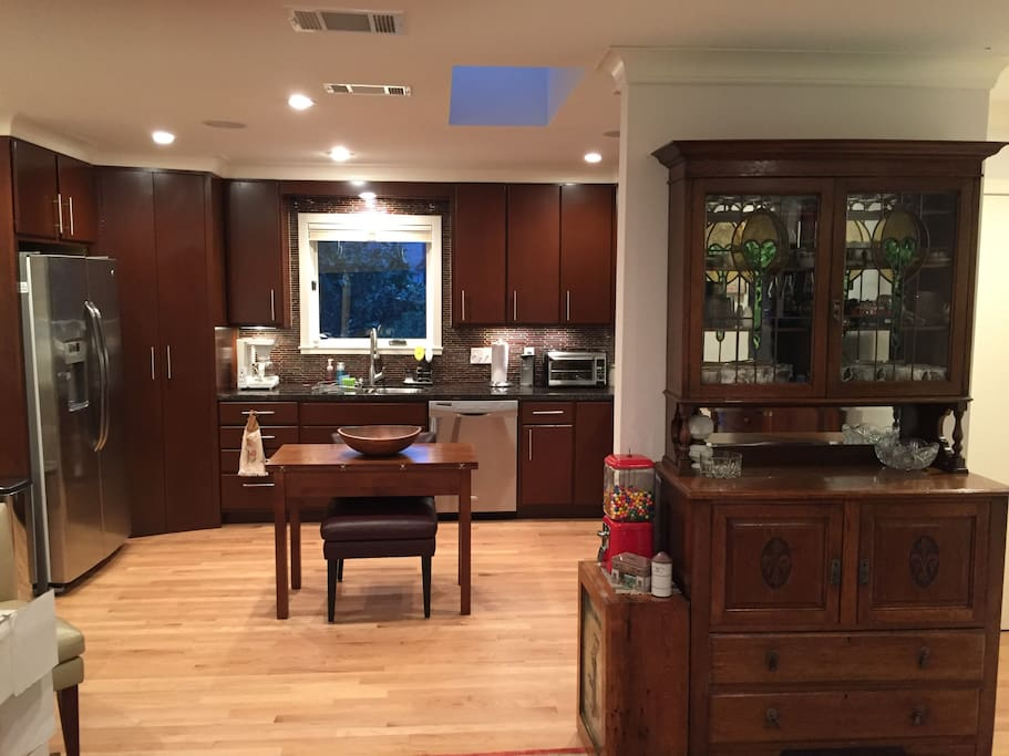 Open concept kitchen w/skylight.  Chef's kitchen w/stainless appliances & granite counters.
