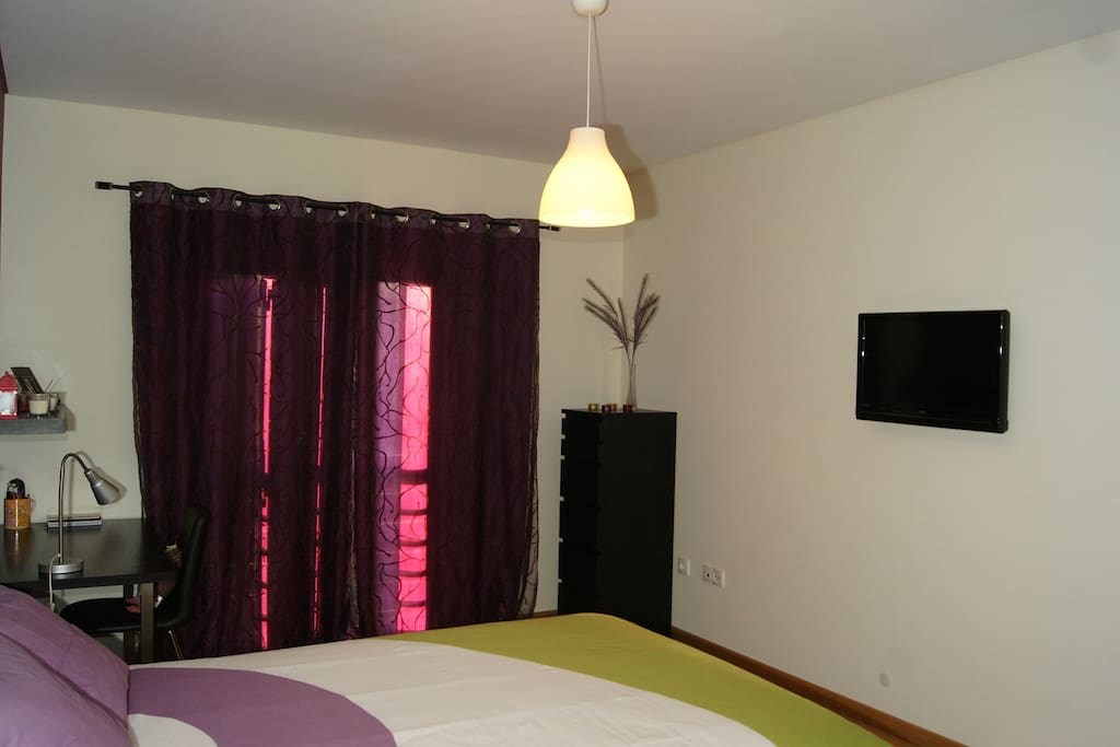 Large bedroom with TV