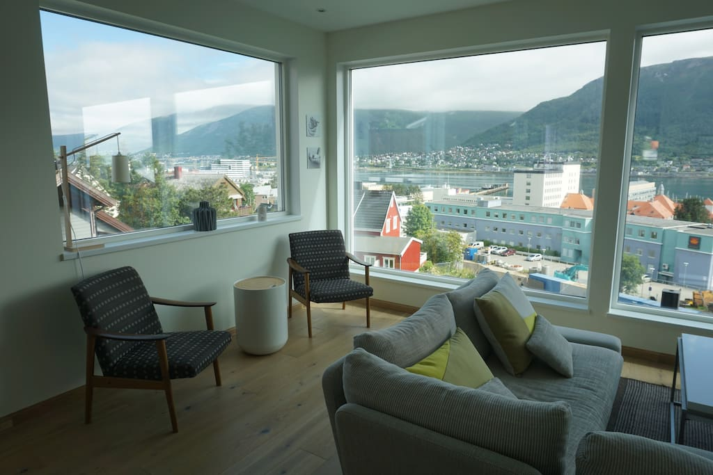 Living room with panorama view over mountains and city