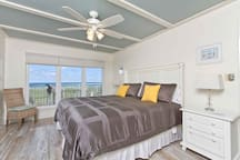 The master bedroom has a king-size bed and more views. The sun comes up over the Gulf of Mexico.