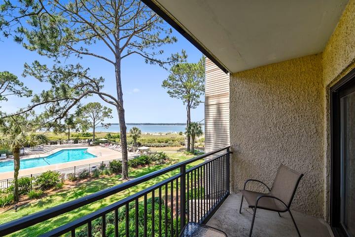 Stylish 2 bedroom / 2 bath Beachside Tennis villa with Calibogue Sound views, community pool.