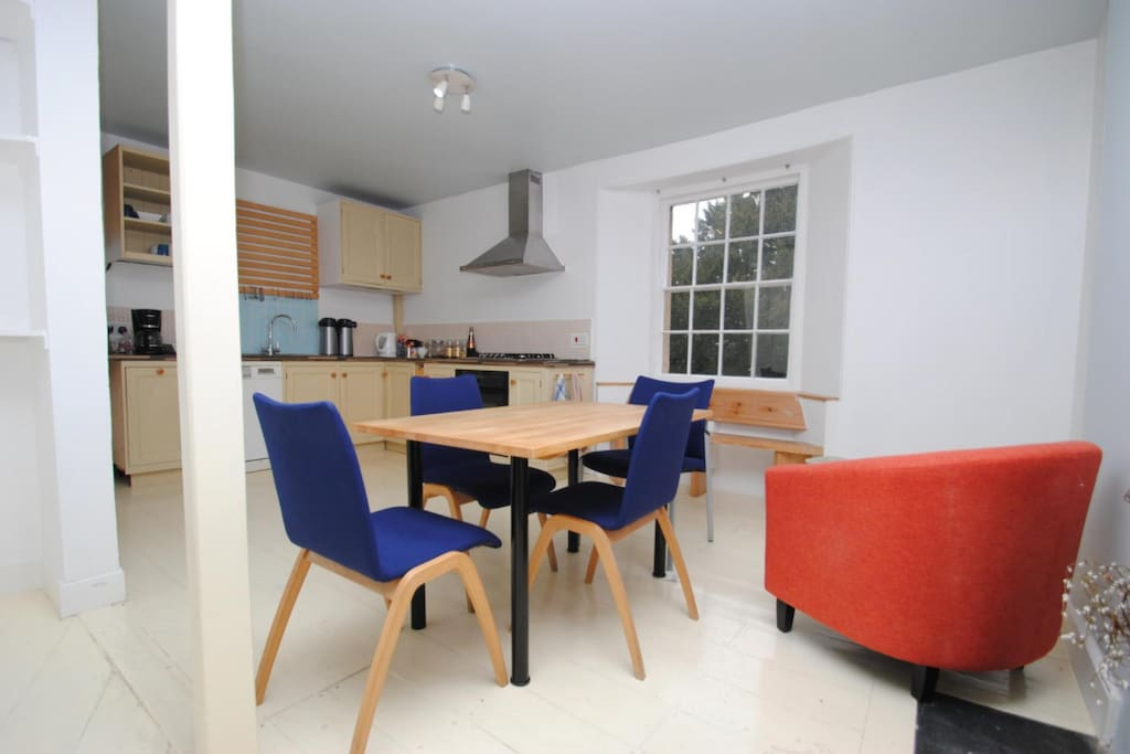 The kitchen/diner is well equipped and doors lead onto the roof garden (chairs have been updated since photo)