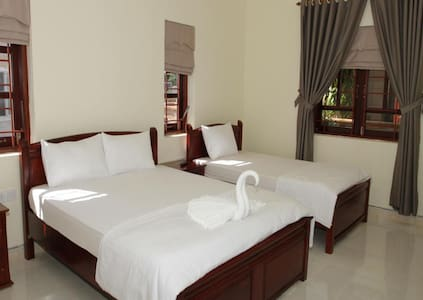 Triple bed room in Mangala Village Phu Quoc