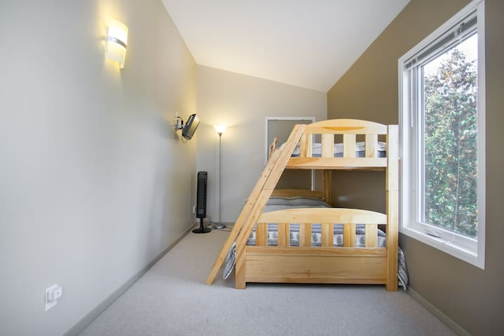 Bunk bed room has a double  on bottom single on top plus another bunk bed added to this room