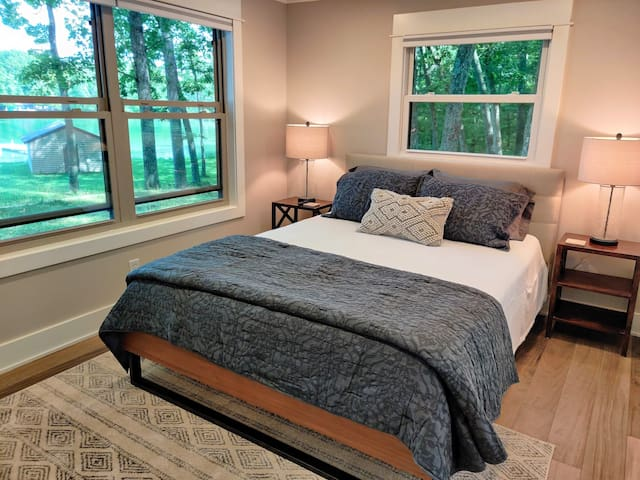 Bedroom #1 has a queen bed, closet, Roku smart TV and a great view of Bills Lake!