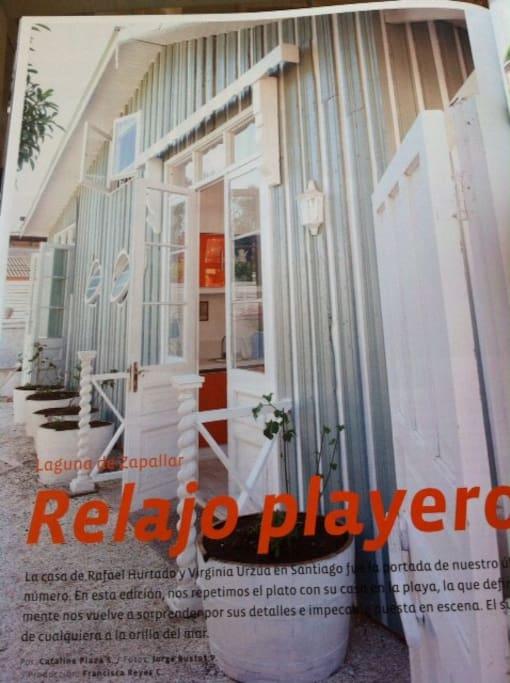 Casa playera con patio de conchuelas de tonos aguas