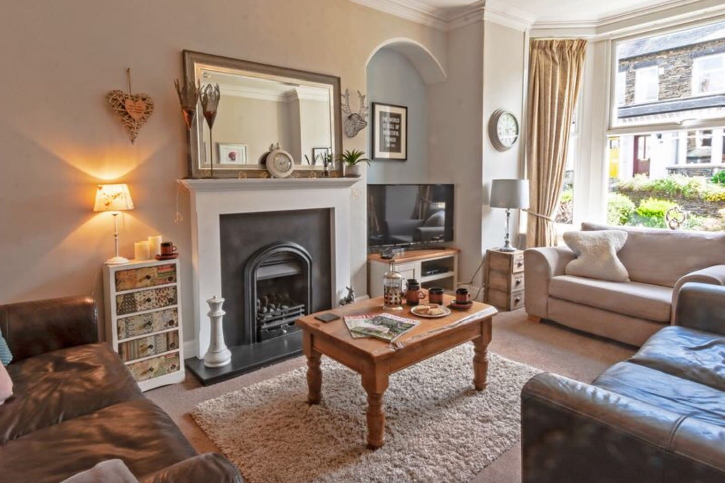 Bright and spacious family lounge with gas fire.