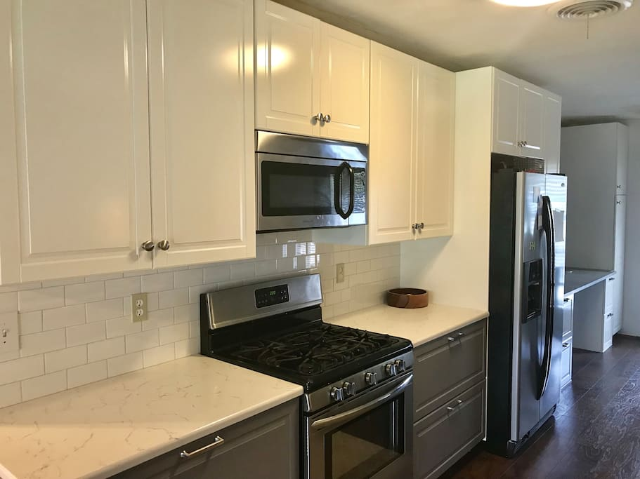Recently remodeled kitchen with all the kitchen gadgets you would ever need. Make some delicious meals with the gas stove, coffee pot, toaster, waffle iron, crock pot and pots and pans.