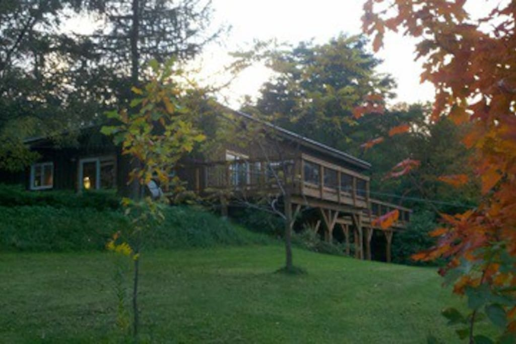 View of second-story deck. overlooking pasture and pond