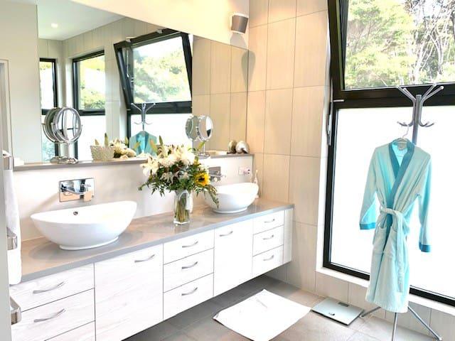 Mastere Bedroom with elegant en suit Bathroom; floor to ceiling glass window to enjoy bush view from big shower