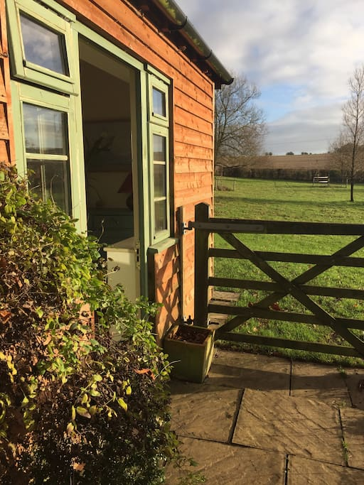 Front door and paddock beyond