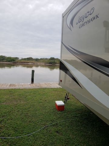 RV Camper on the Water with fishing dock