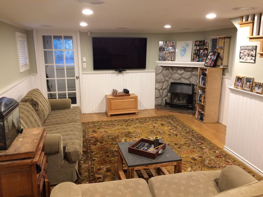 Large living room with adjacent mudroom and private entrance. Gas fireplace, large screen TV, WiFi and Xbox.