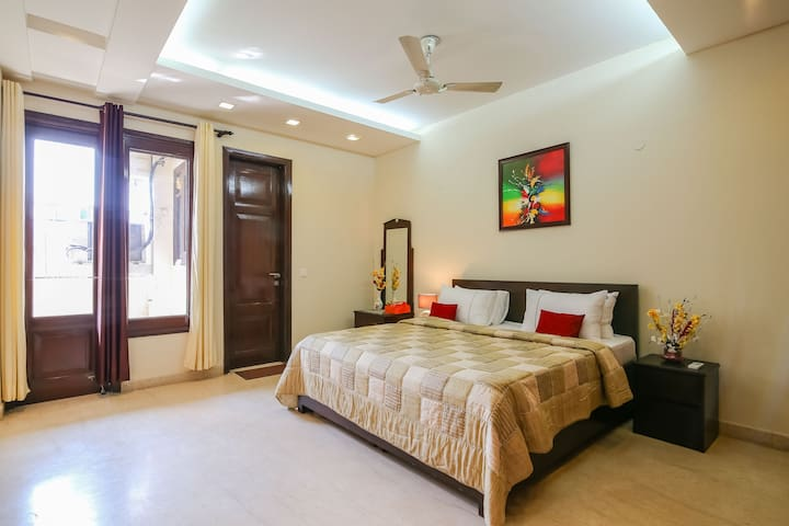 Spacious large room with attached balcony