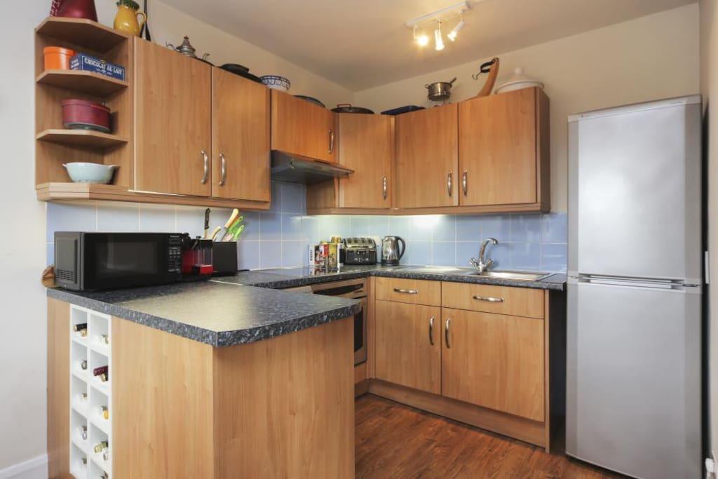 Kitchen with fridge, freezer, oven, dishwasher and washing machine