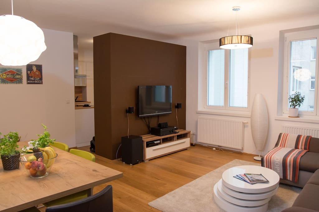 The big living room which is connected to the kitchen comes with your own TV and sound system.