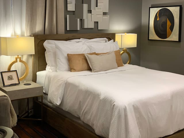 Welcome home! Queen-sized bed. Down alternative comforter and pillows available in the walk-in closet.