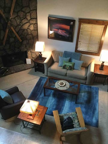 Living room with lava rock fireplace.  Leather, electric recliner, flat screen TV, DVD blue ray player.  DVD movies.