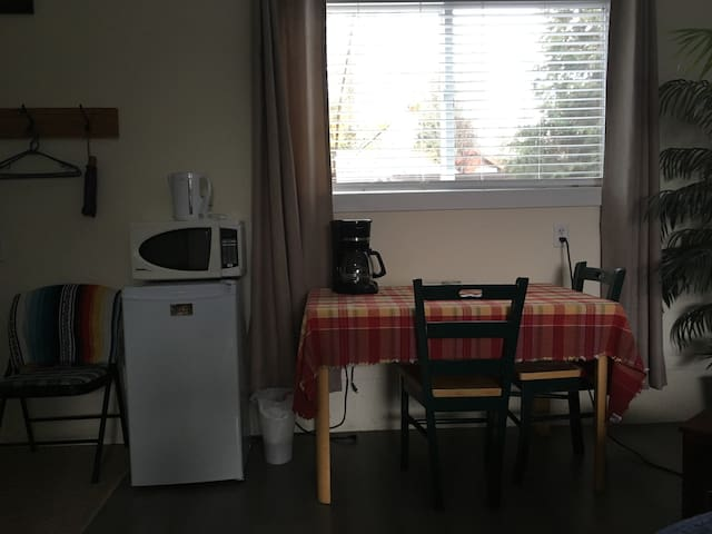 Fridge, Microwave and table work station.