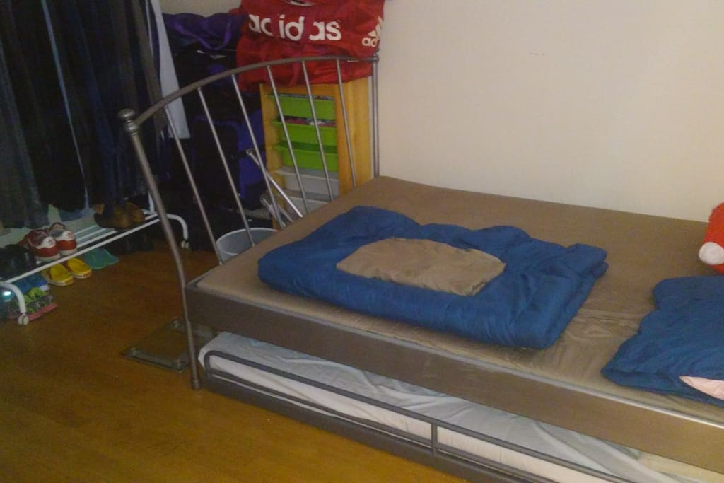 Queen size IKEA bed with pull-out bed.