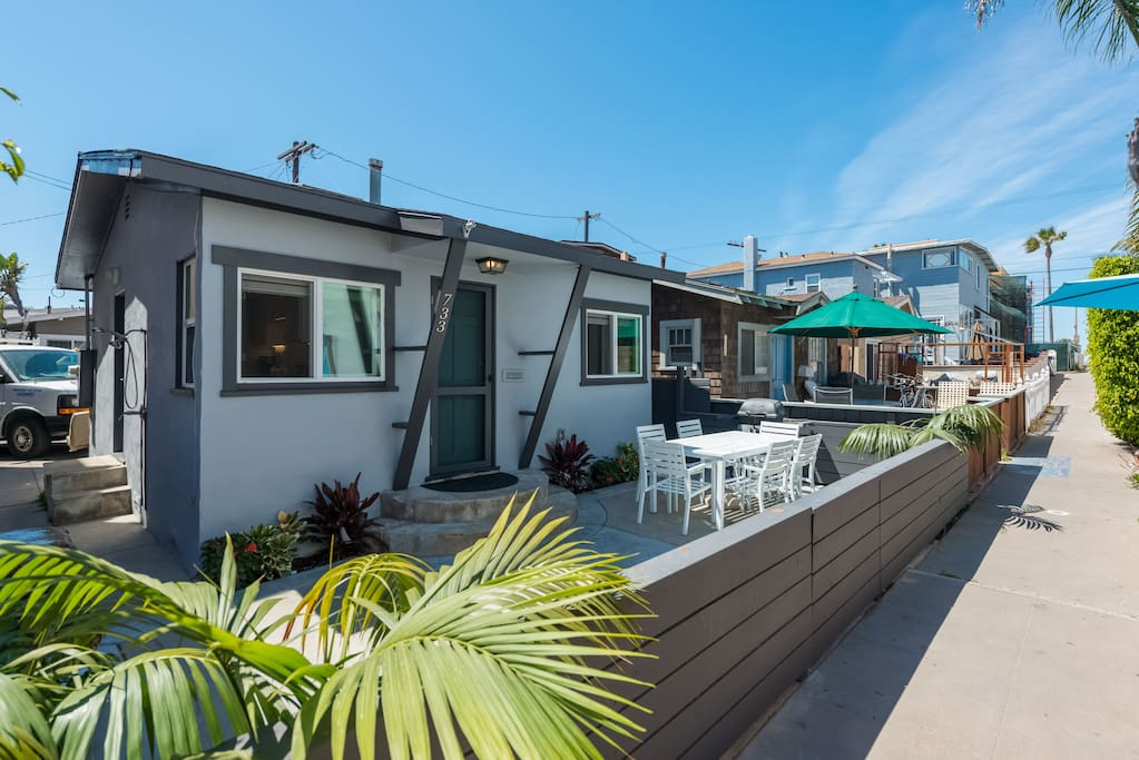 Completely remodeled beach bungalow located on the beachside of the Mission Beach peninsula, just steps to the beach- no traffic to cross. outdoor hot shower as well.