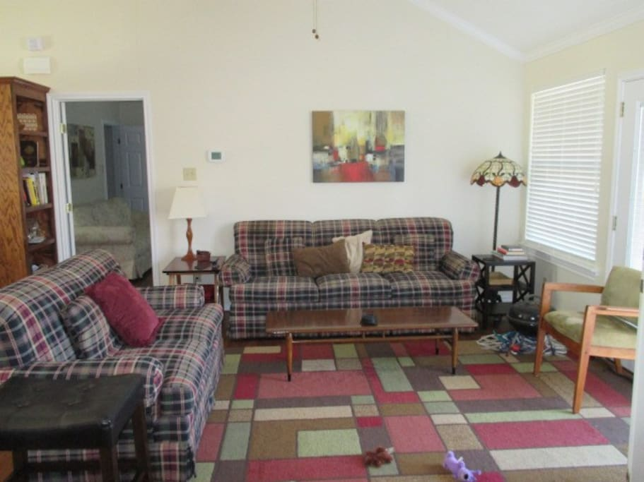 "Living Area also features a small round Pub table with chairs, and a 60"" TV w/DVD Player and assorted DVD's. Lamps, Lighted Ceiling Fan."