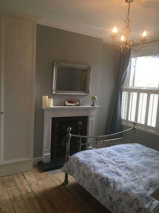 Blackout curtains, built in wardrobe and stripped floorboards