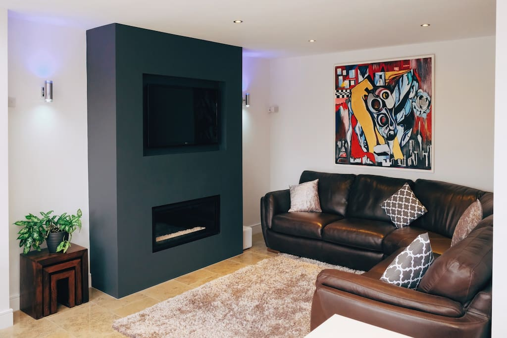 Main Living Area - relax on corner leather sofa / TV / insert gas fire