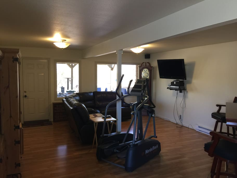 Living area: cable TV, VHS/DVD player, DVDs games, books, elliptical windows overlook valley and Sierra Nevada Mountains locking doors for privacy and security
