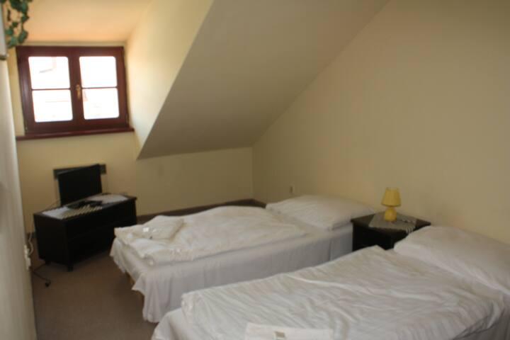 Čtyřlůžkový pokoj se dvěma ložnicemi v Kaplici