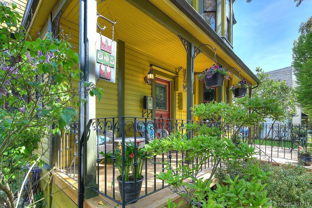 """Spacious front porch where you can relax and what I call """"stoop"""". Sit, relax (maybe with a glass of wine)and watch people come and go down the street."""