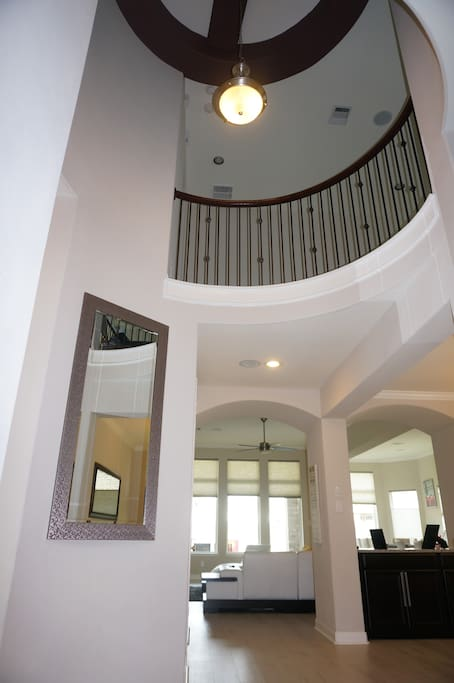 Stunning rotunda entry with soaring ceilings