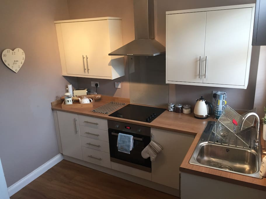 Kitchen with halogen hob and fan oven, fridge freezer and washer dryer