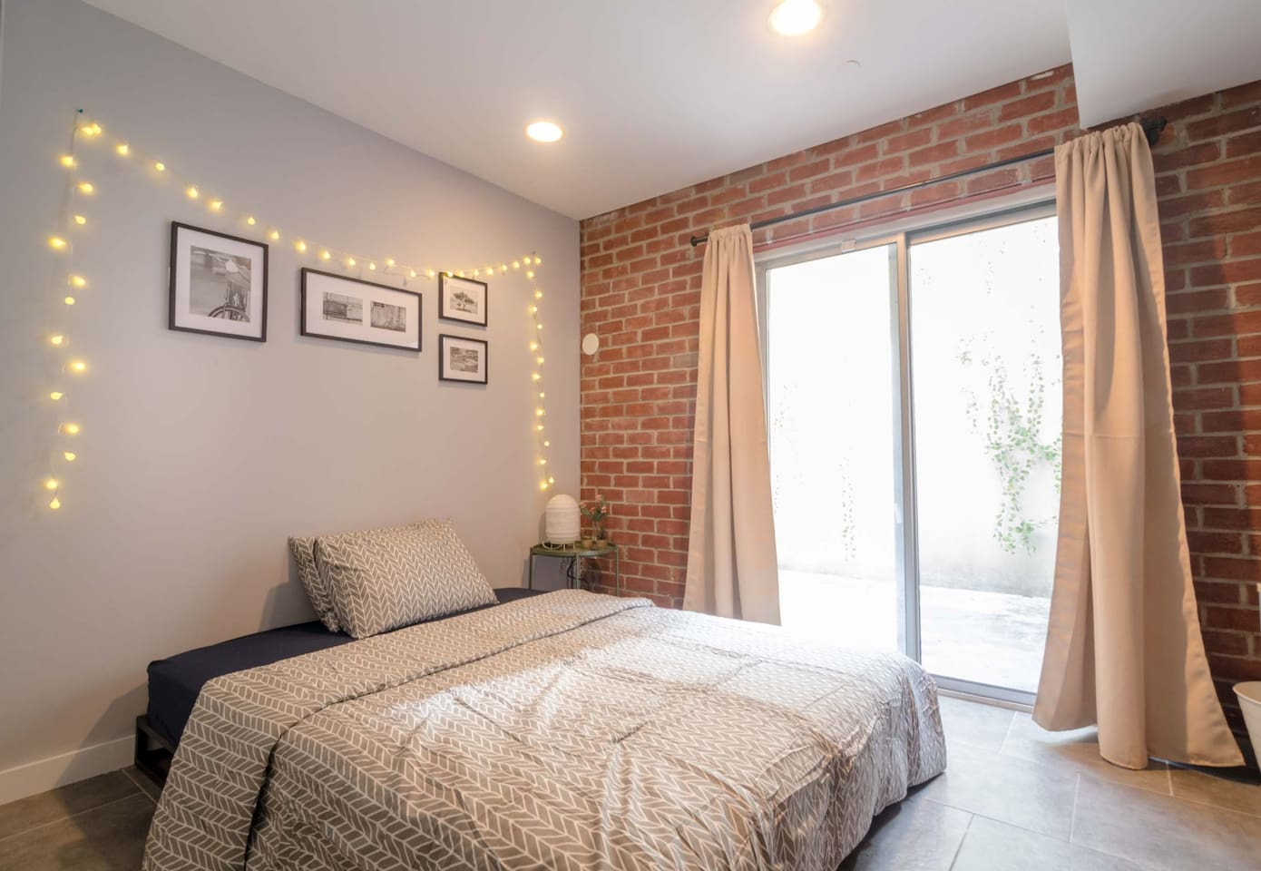 Charming room with exposed brick and outdoor space!