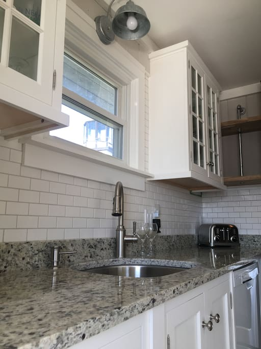 Beautiful new kitchen with inlay cabinets, stainless appliances and granite counter top.