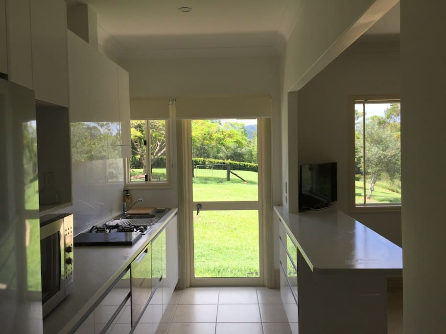 Kitchen leading out onto garden and patio area