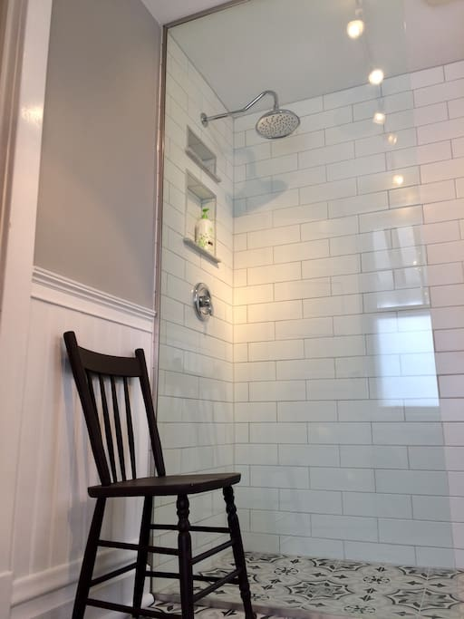 Freshly renovated bathroom with rainfall shower.