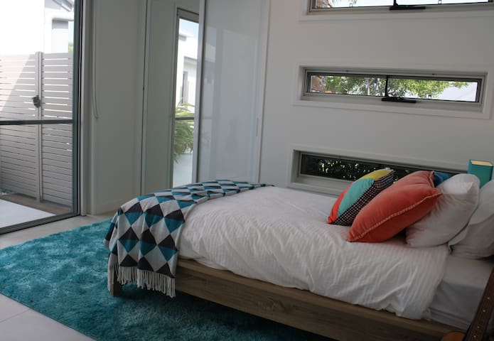 The Second Private Bedroom has a King Single Bed with Direct Access to the Pool via a private courtyard.  All Bed Linen, Bath Towels and Beach Towels Included