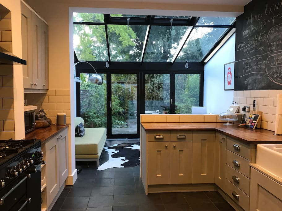 Kitchen diner 1 with bi-fold doors leading to patio garden