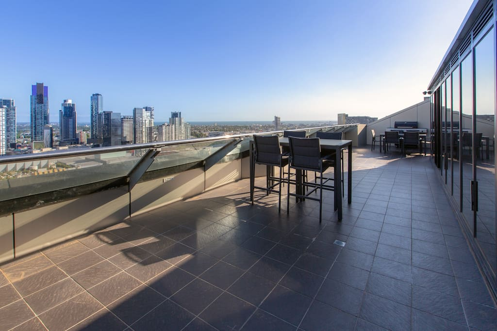 Large private terrace with dining facilities boasting amazing city and river views