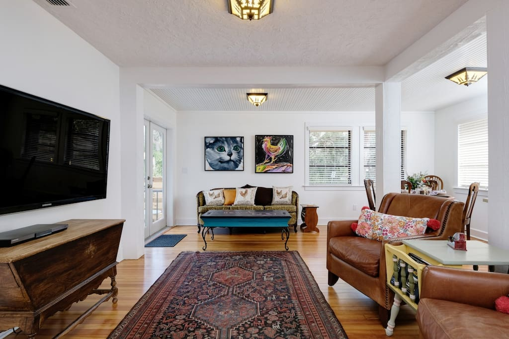 """Living Room with wall-mounted 55"""" HDTV and DVD player."""