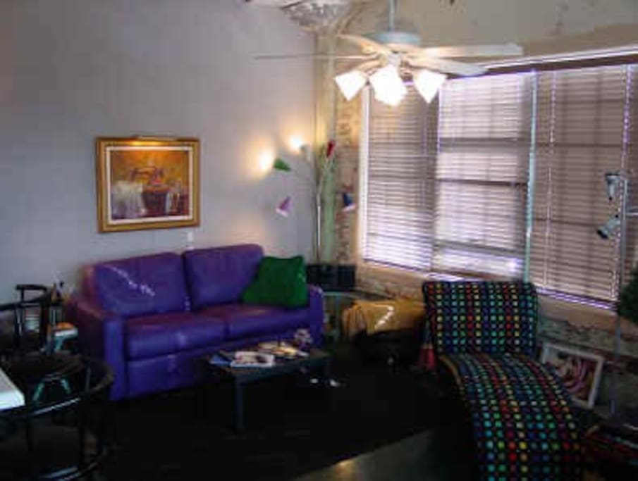 Purple Couch opens into a Queen size bed.