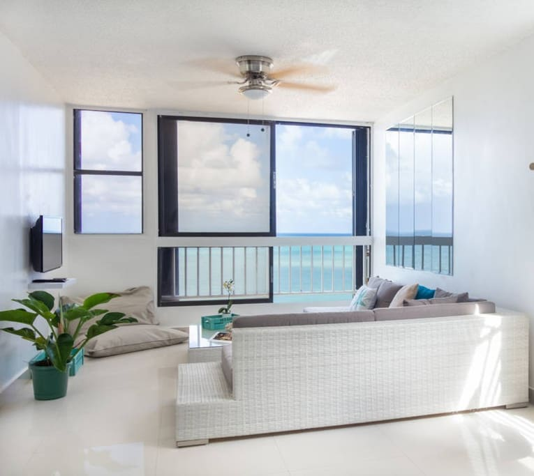 """Living room features a beautiful ocean view. 32"""" LCD HD Cable TV. 2 people can sleep in the living room. The couch can be used as 2 twin size beds or can be combined into one queen size mattress if put together."""