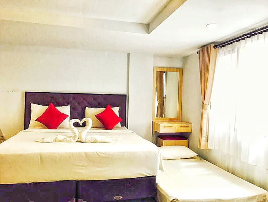 Enjoy the bedroom with extra bed for 3 person inside, but the room definitely can be fit till 4 person. If you're Traveller with low budget! Come and Book in Our place. This is our actual room set up.