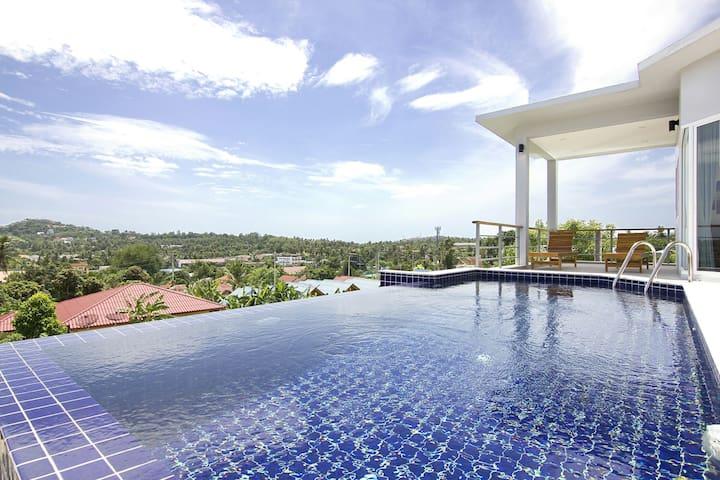 top floor infinity pool and sunbeds