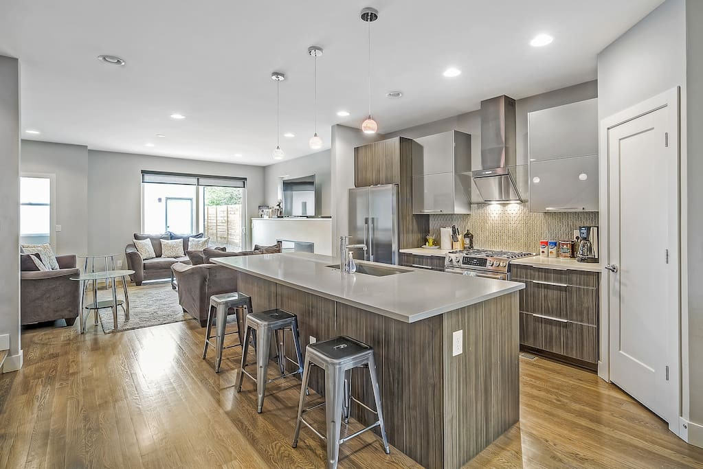 High end kitchen with stainless steel appliances.