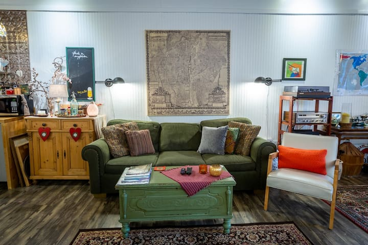 Living area: the couch is comfy, and there is thoughtful mood and task lighting throughout.