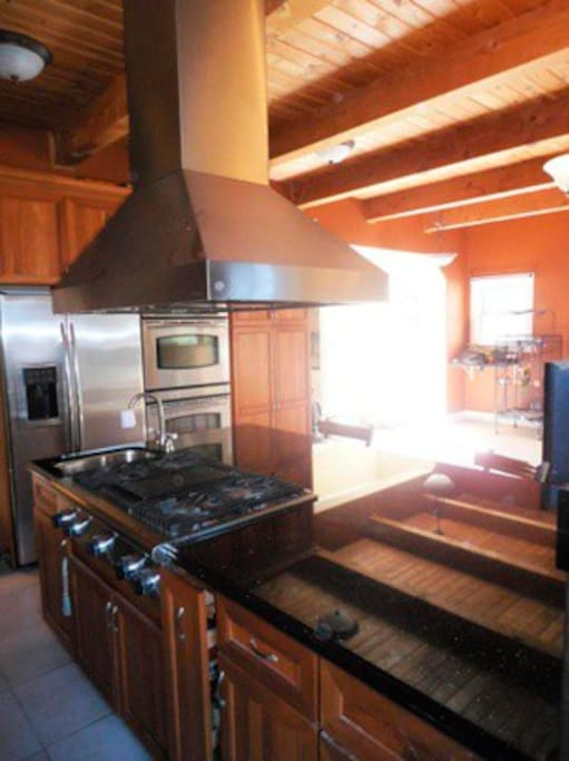 Spacious full kitchen with dual ovens.