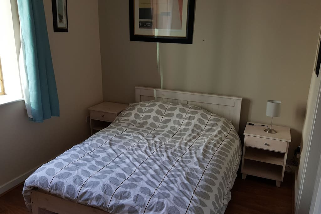Comfortable double bed with natural light in the morning